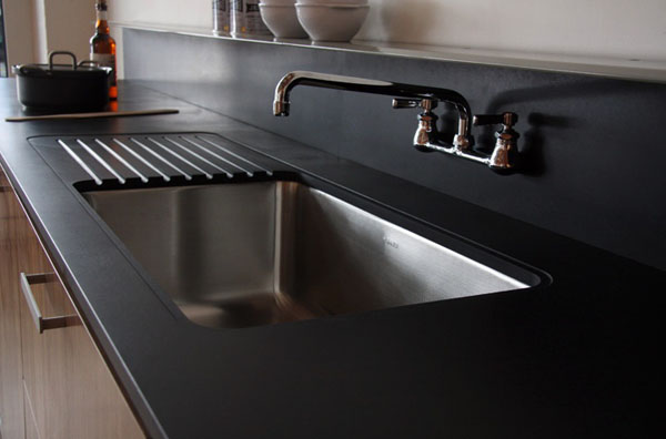 black-kitchen-counters-and-backsplash